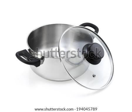 stainless steel cooking pot with open glass lid, black handle isolated  - stock photo