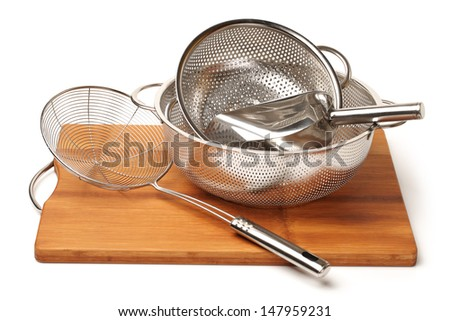 Stainless steel cookware on white background  - stock photo