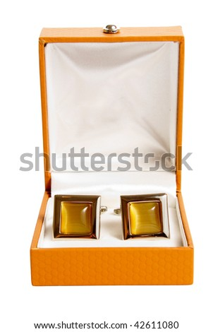stainless steel cufflinks on the brown leather box isolated on white background - stock photo