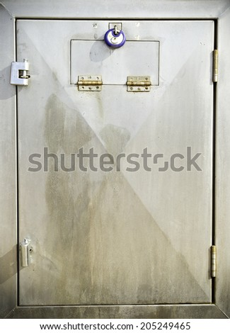 stainless steel door with a steel locks attached - stock photo