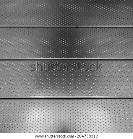 Stainless steel dots on metal footpath as tactile paving - stock photo