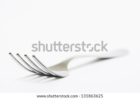 Stainless steel fork on white backround - stock photo