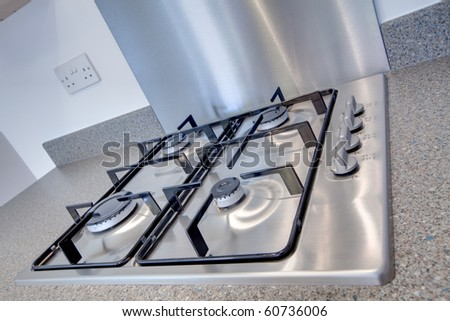 Stainless steel four burner gas hob detail - stock photo