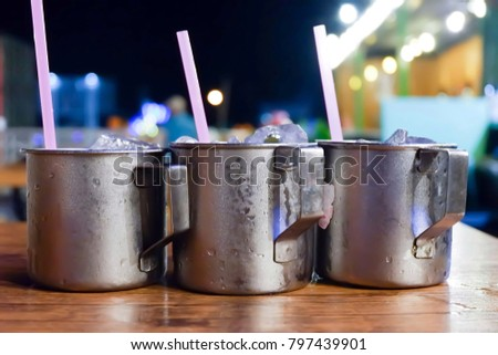 Stainless steel in ice on wood table Bokeh background