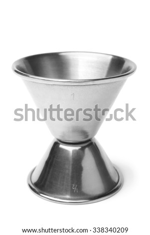 Stainless steel jigger on white background - stock photo