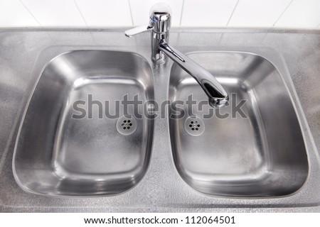 Stainless steel kitchen wash sinks - stock photo