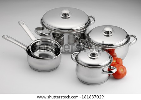 stainless steel kitchenware on neutral background - stock photo