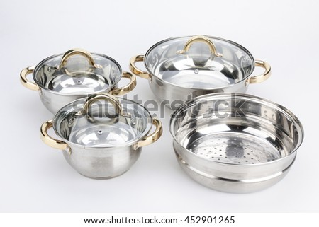 Stainless steel metal cooking pot pan over isolated white background. - stock photo