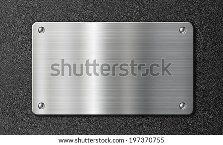 stainless steel metal plate over black texture - stock photo