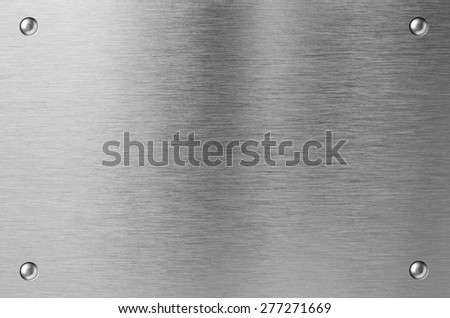 stainless steel metal plate with rivets - stock photo