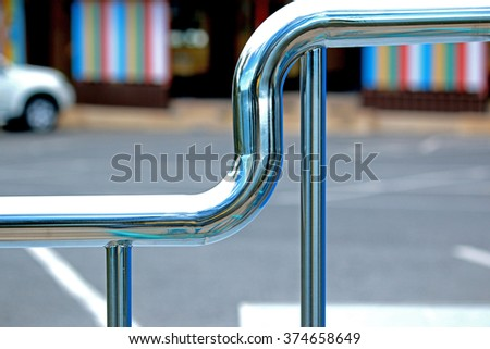 Stainless steel pipe fence - stock photo