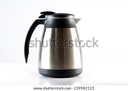 Stainless steel pitchers on white background - stock photo