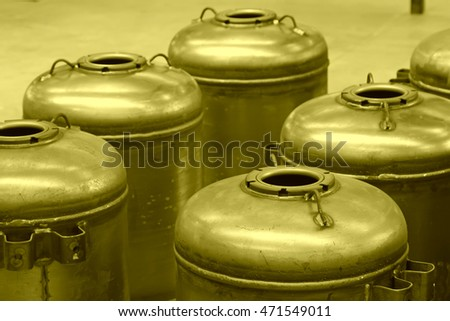 Stainless steel pressure tanks in a production workshop, closeup of photo