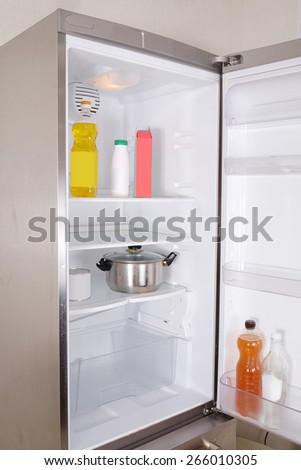 Stainless steel refrigerator -  door is open - stock photo