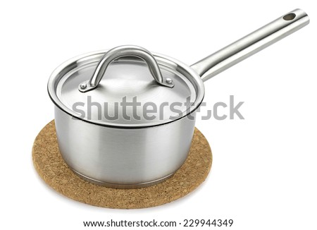 Stainless steel saucepan over cork trivet isolated on white background. - stock photo
