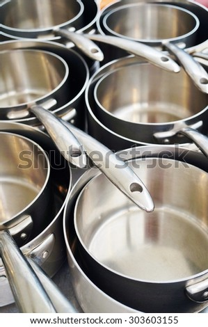 Stainless steel saucepans in a professional kitchen