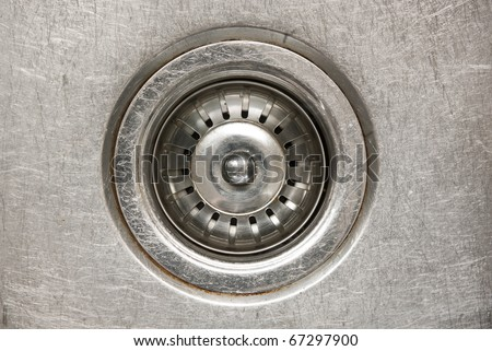 Stainless steel sink plug in a sink with water