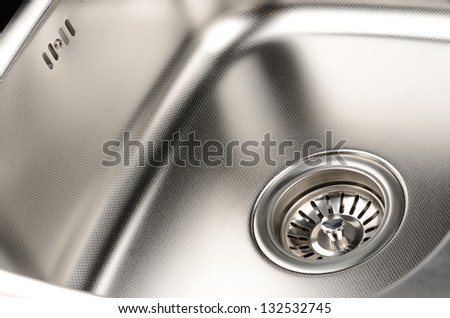 Stainless steel sink with drain. Closeup. - stock photo