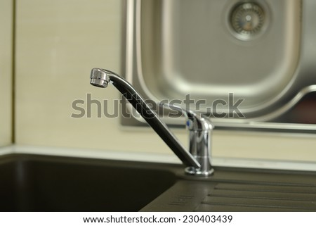 Stainless steel sink with drain. Closeup. Close up of washbasin in a kitchen  - stock photo