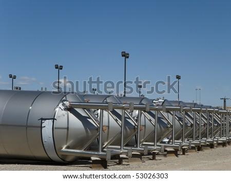 Stainless steel storage tanks - stock photo