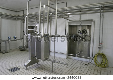 stainless steel temperature controlled pressure tanks and valves in factory - stock photo