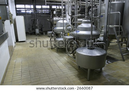 stainless steel temperature controlled pressure tanks in factory - stock photo