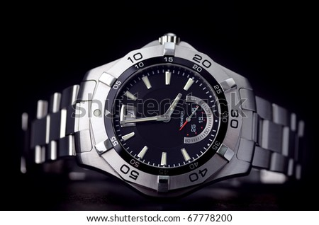 Stainless steel watch - stock photo