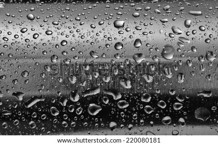 Stainless steel with water drops on the rounded surface. Background, texture, design element. - stock photo