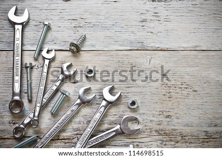 Stainless steel wrench set on wood background - stock photo