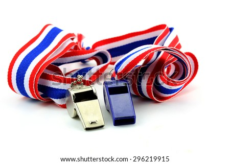 stainless whistle and blue plastic whistle with Thailand national flag lanyard in heart shape on white background - stock photo