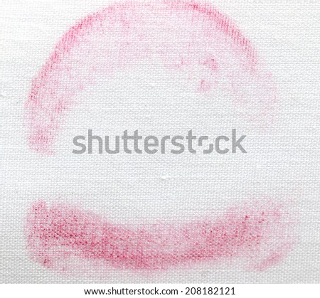 stains of lipstick on a white cloth - stock photo