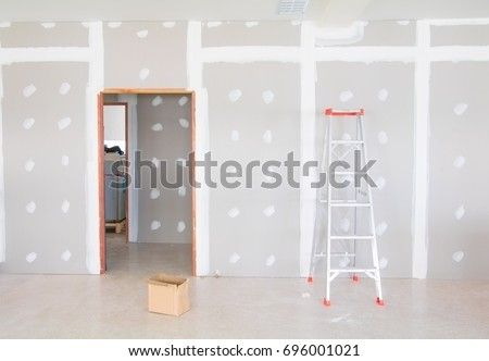 Stair And Gypsum Board Wall Interior Decoration Of Home At Construction Site  With Copy Space Add