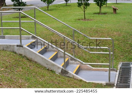 Stair Step In The Park With Stainless Steel Handrail - stock photo
