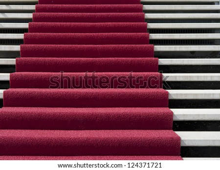 stair with red carpet in front of an hotel - stock photo