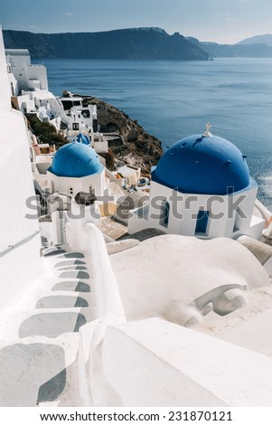 Staircase and domes of the churches in Oia, Santorini (Cyclades), Greece.