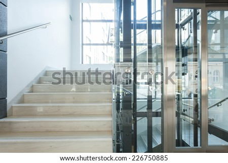 Staircase and elevator in a business centre - stock photo