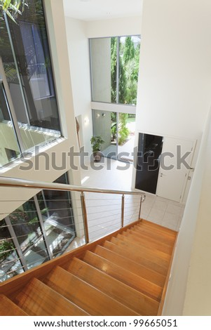 Staircase and entrance in luxurious house. - stock photo