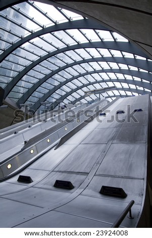 staircase at canary wharf metro station, london - stock photo