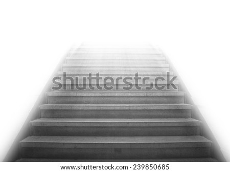 Staircase going up to the white light with isolated background,gray color monotone picture - stock photo