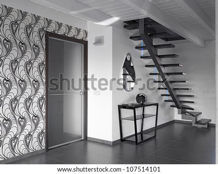 staircase in a modern living room with a glass door - stock photo