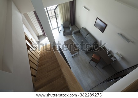 staircase in duplex apartment interior - stock photo