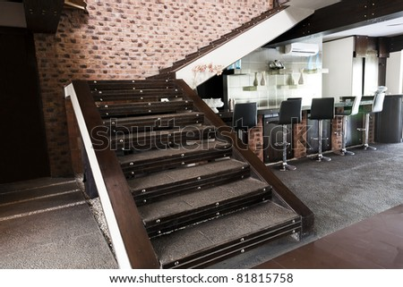 staircase in living room with a drinks bar
