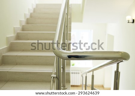 Staircase in modern building. Closeup stainless steel handrails. - stock photo