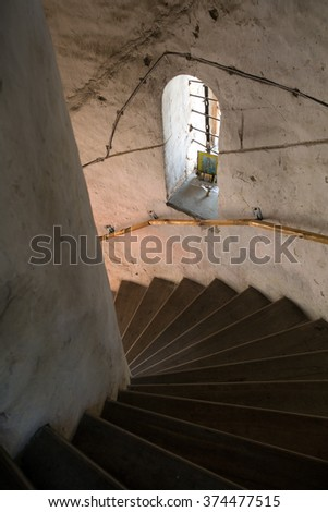 Staircase in the temple, and a window with icons - stock photo