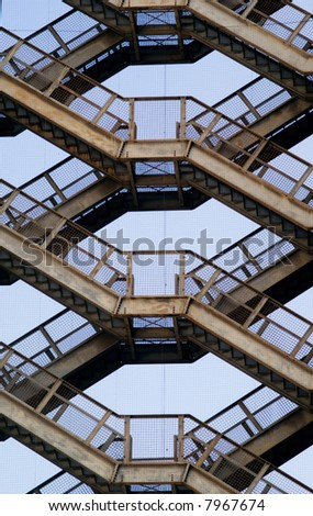 Staircase rises against a blue sky - stock photo