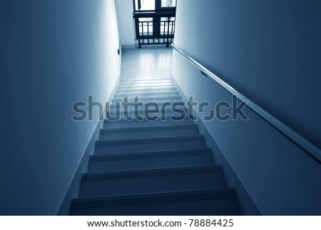 Staircase with light fire exit of a building. - stock photo
