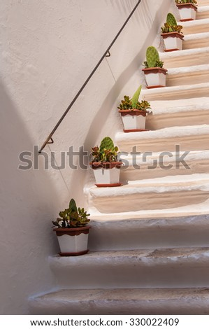 Staircase with plants in Locorotondo, Puglia, Italy. - stock photo