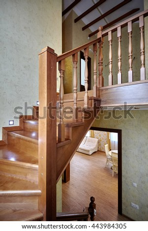 staircase with wrought iron railing