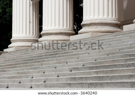 Stairs and columns of a monumental stone building - stock photo