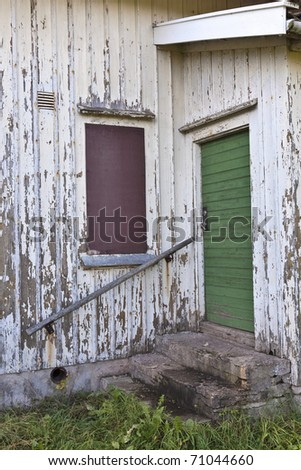 Stairs and door to the cottage - stock photo